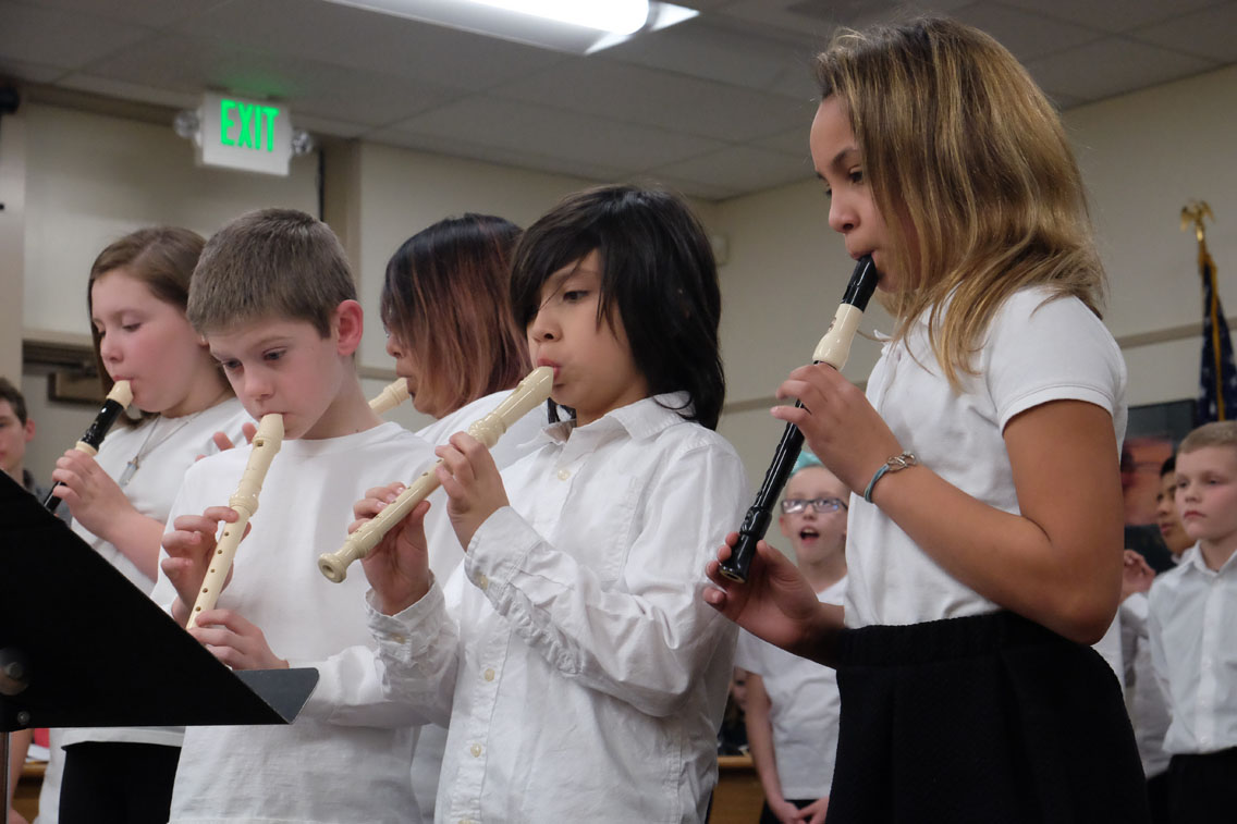 Members of the Lafayette Honors Choir playing instruments.